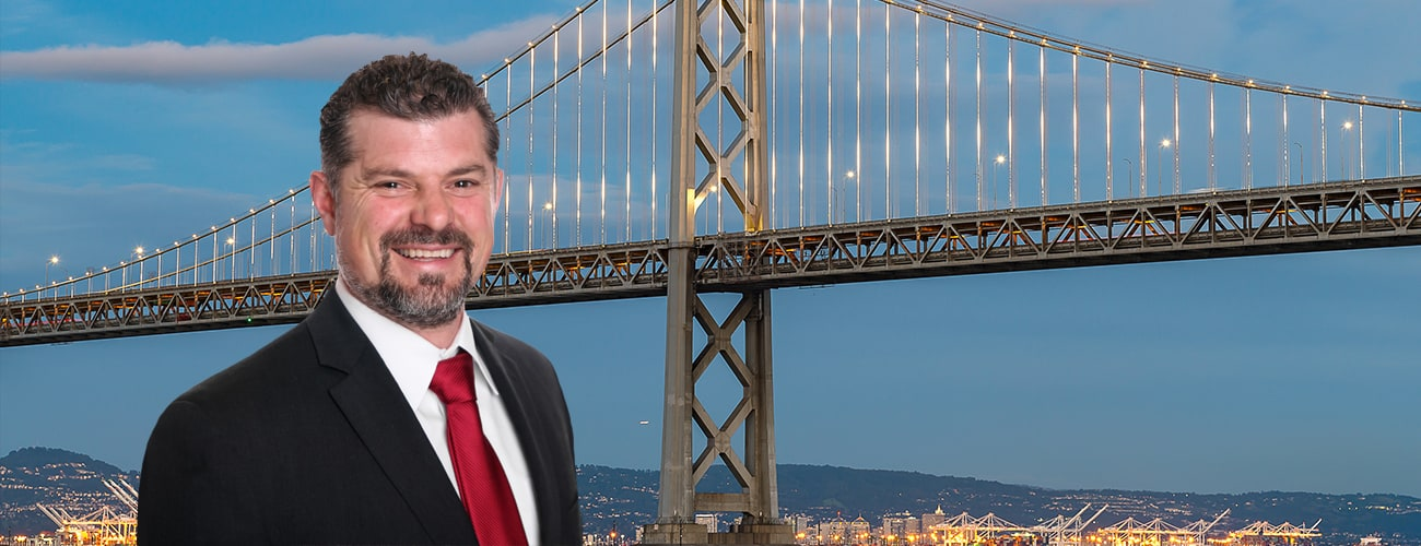 Spencer C. Young picture over background of San Francisco-Oakland Bay Bridge